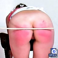 Paris is ordered to remove her tight white skirt and panties and bend over a chain so her caning session can begin