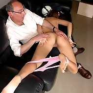 Innocent looking girl gets a harsh OTK spanking on her bared buttocks