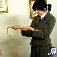 Schoolgirl bitch is caned brutally over the desk until tears are flowing
