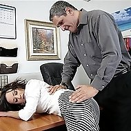 Brunette gets spanked on deskBrunette gets spanked on desk