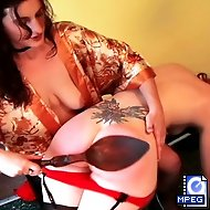 Amber kneels on a chair in the kitchen while Kaluous spanks her sexy ass