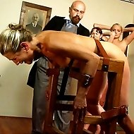 Tied over a bench and caned until cries and tears of pain